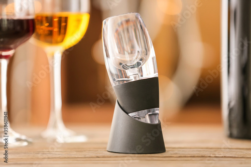 Wine aerator on wooden table Canvas Print