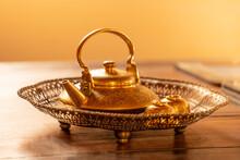 Golden Tea Pot In Antique Bras...