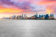 Empty square floor and modern city scenery at sunrise in Hangzhou,China.