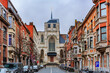 canvas print picture - View on medieval St Peter's church and traditional brick houses in Leuven, Belgium