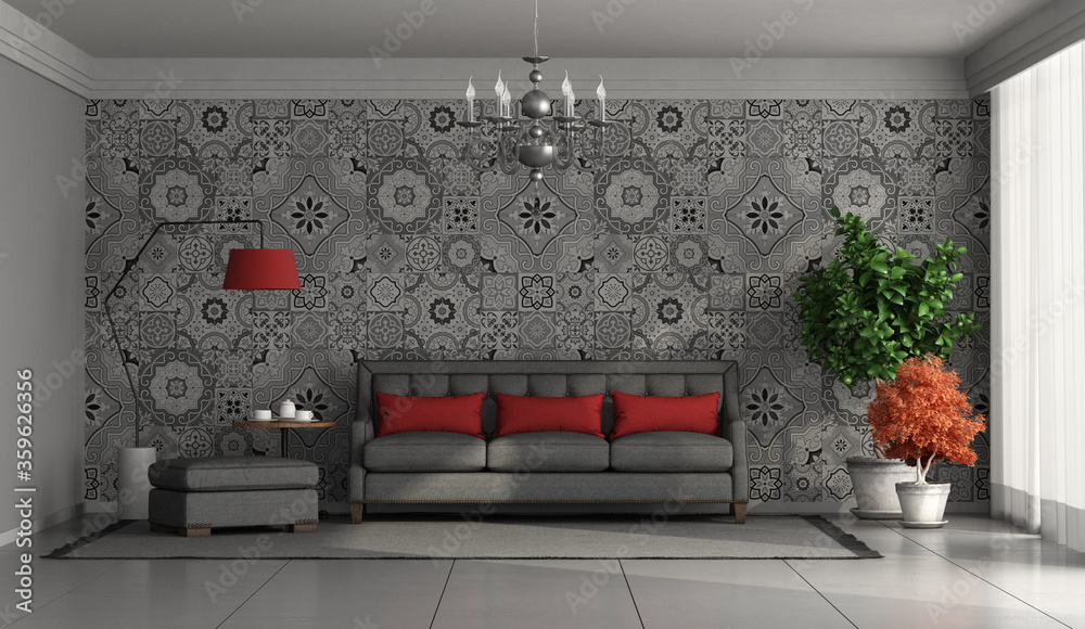 Living room with modern sofa against wall with retro tiles on background