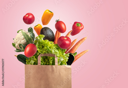 Vegetable bag with pink background, space for copy Fotobehang