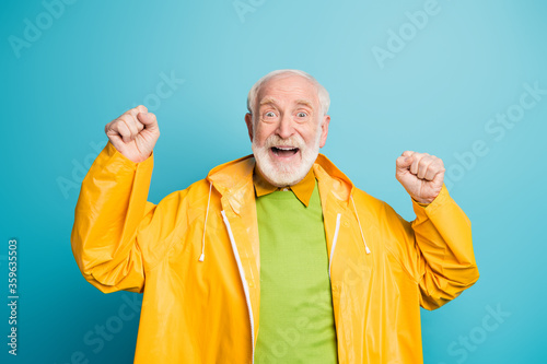 Portrait of his he nice cheerful cheery lucky grey-haired man wearing topcoat ce Wallpaper Mural