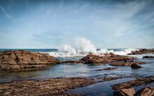 A Landscape Photo Of Waves Bre...