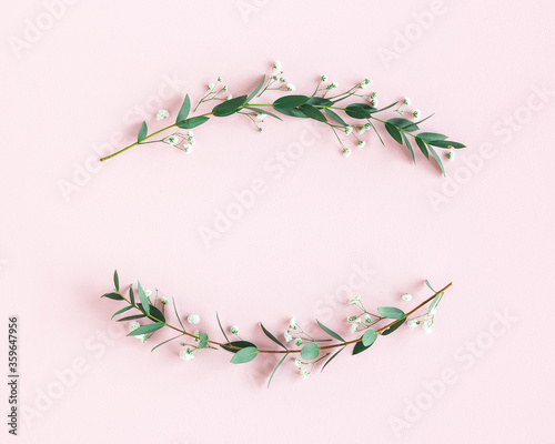 Obraz Flowers composition. Wreath made of gypsophila flowers, eucalyptus leaves on pink background. Spring concept. Flat lay, top view - fototapety do salonu