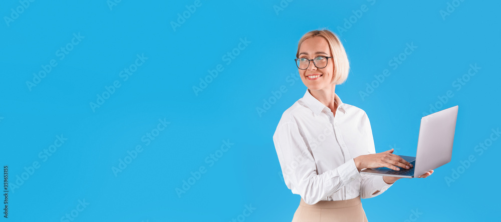 Fototapeta Happy millennial business lady with modern laptop on blue background, space for text