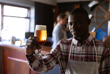 African American Man Working At A Microbrewery Pub