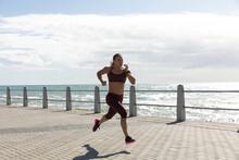 Sporty Caucasian Woman Training On Seaside