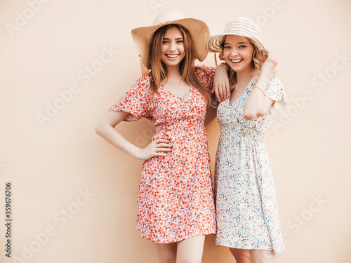 Fotomural Two young beautiful smiling hipster girls in trendy summer sundress