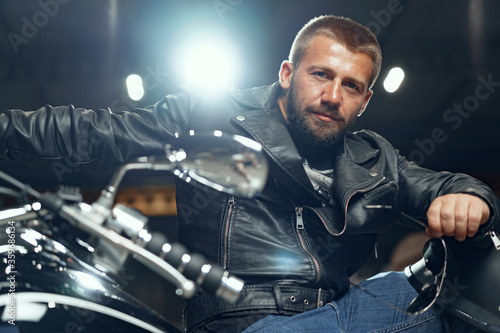 Papel de parede Portrait of motorbike rider in black leather outfit