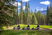 Row Of Empty Electric Carts On The Side Of The Golf Course, In Banff, Alberta, Canada