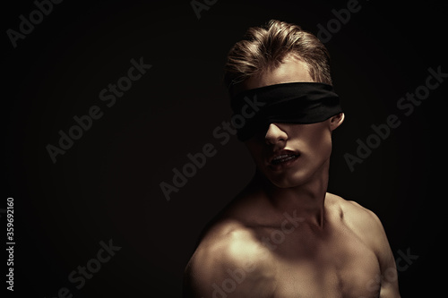 naked guy with blindfold Canvas Print