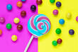 canvas print picture - Colorful lollipop on bright two tone background. Holiday composition.