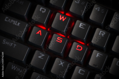 Photo WASD keys light up in red on cool RGB mechanical gaming keyboard