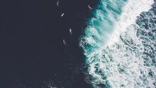Top View From Altitude Of Group The Surfers Are Swimming On Surfboards In Ocean After Big Wave Breaking At Beautiful Shoreline. Concept Of Aspiration And Pursuit On Example Of Fight With Ocean Current