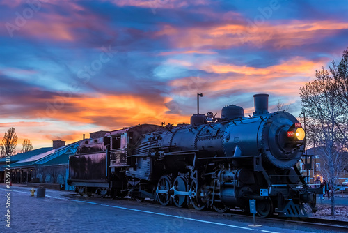 The train to the Grand Canyon waiting at Williams Station, Arizona illuminated b Wallpaper Mural