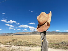Cowboy Cowgirl Hat On Wood Fence Post