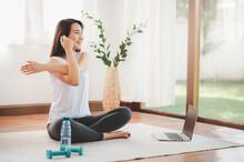 Asian Woman Doing Yoga Shoulde...