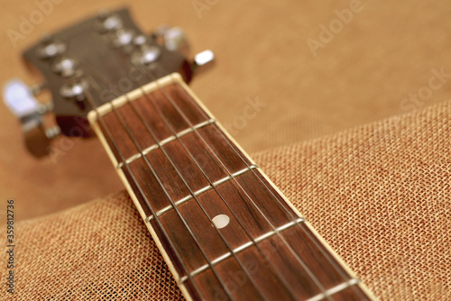The neck of the guitar close up. Fototapeta