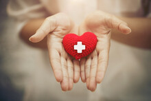 Hand Giving Red Heart For Help...