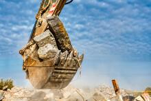 An Excavator Spills Soil Out O...