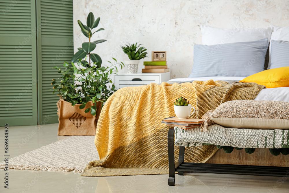 Fototapeta Stylish interior of bedroom with houseplants