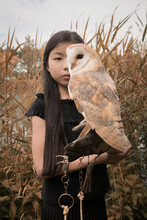 Portrait Of Girl Holding Barn Owl