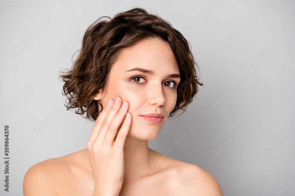 Fototapeta Portrait of lovely pretty charming girl have skin care plastic surgery procedure look in mirror touch finger hands face isolated over gray color background