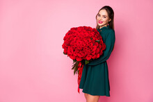 Photo Of Attractive Charming Fancy Lady Red Lips Hold Large Roses Bouquet Secret Admirer Boyfriend Birthday Compliment Wear Green Mini Dress Isolated Pastel Pink Color Background