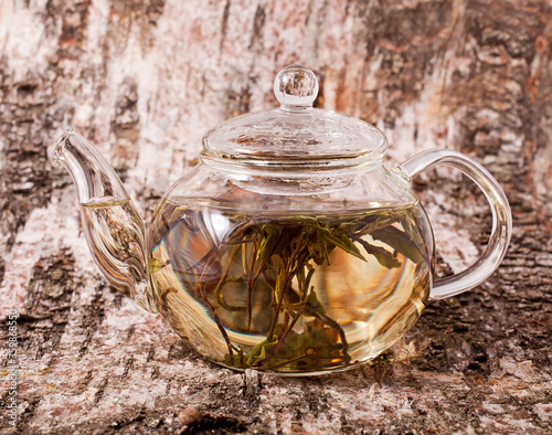 Bai Mu Dan (White Peony) white tea in the transparent teapot on the birch bark b Slika na platnu