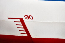 """Marking The Water Depth On The Hull Of A Vessel With The Number """"90"""", Red And White"""