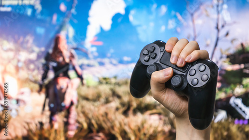 Man hand holding joystick while playing the game. Canvas Print