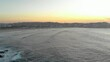 Early morning surfers in Bondi, take to the waves to see the sunrise and enjoy the tranquility.
