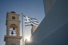 Greek Flag Flying Against A Bl...