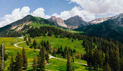 Fotografie, Obraz Aerial view of picturesque valley in area of wild green Swiss hills