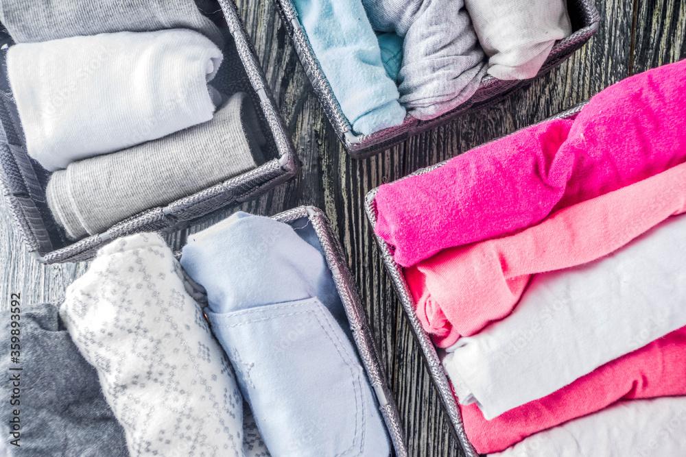 Fototapeta Vertical Marie Kondo tidying clothes method