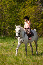 Little European Girl Rides A W...