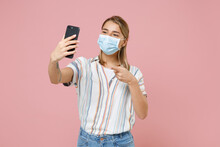 Young Woman Girl In Casual Striped Shirt Sterile Face Mask Isolated On Pink Background. Epidemic Pandemic Coronavirus 2019-ncov Sars Covid-19 Flu Virus Concept Doing Selfie Shot Point On Mobile Phone.