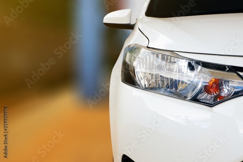 close up of front view of white car When parked at home Canvas Print