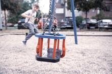 Empty Swing On The Playground