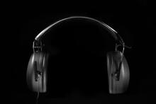 Black Headphones In Dark Envir...