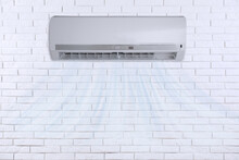 Modern Air Conditioner On Whit...