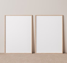 Vertical Wooden Frame Mock Up On Beige Floor. Set Of Two Wooden Frame Mock Up Poster. Two Vertical Frame 3D Render