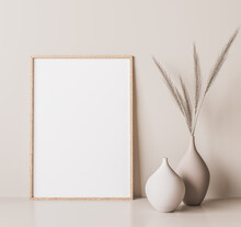 Vertical Wooden Frame Mock Up. Wooden Frame Poster, And Simple Vase With Pampas On Beige Wall. 3D Illustrations.