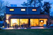 Illuminated House With Furnitu...