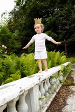 Little Girl Walking On A Balus...