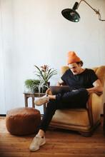 Man Sitting On Armchair At Hom...