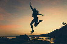 Silhouette Of Jumping Woman At...