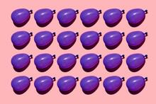 Studio Shot Of Rows Of Purple Water Balloons