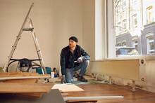 Man Refurbishing Shop Location...